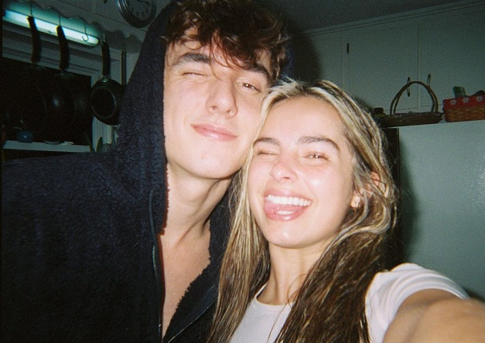 Bryce Hall and Addison Rae making funny faces in the selfie.