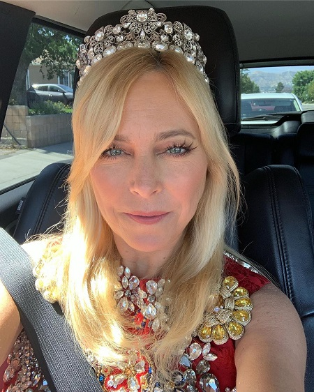 Sutton Stracke taking a selfie with her Tiara and the custom Couture, from Dolce & Gabbana, in her car.