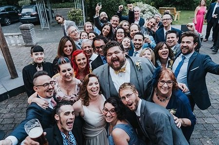Every relative present during the wedding shouting 'Yeah!' at the camera, including Jorge Garcia and his wife, Rebecca Birdsall.