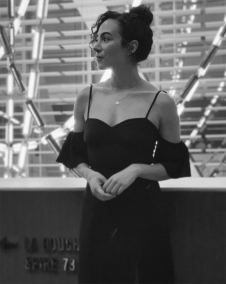 Aurora Perrineau in a black and white image, wearing a dress.