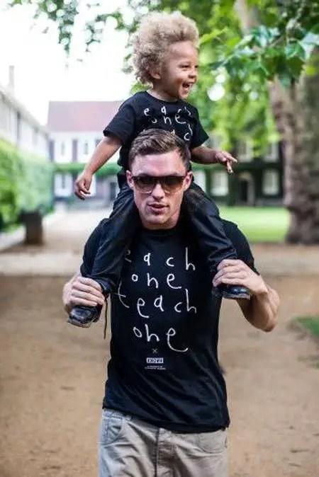 Ed Skrein with his son Marley Skrein sitting on his shoulder.