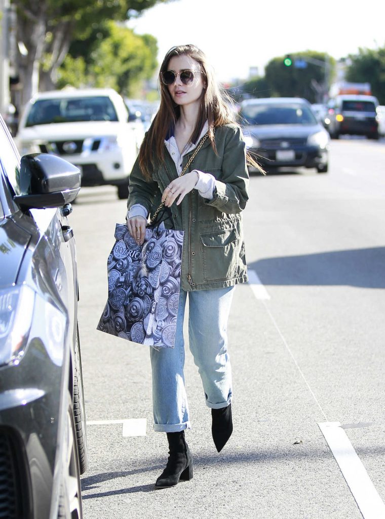 Lily Collins In A Blue Ripped Jeans Was Seen Out In West