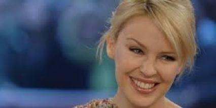 Kylie Ann Minogue OBE is An Australian Singer Songwriter Dancer Actress Her Body Measurements Bra Size Shoe Net Worth