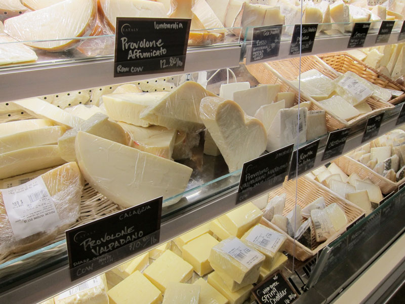 Another of the cases displaying  Italian cheeses at Eataly Chicago