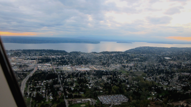 Goodbye, Seattle (aerial view of the sound at dusk). © 2014 Celia Her City