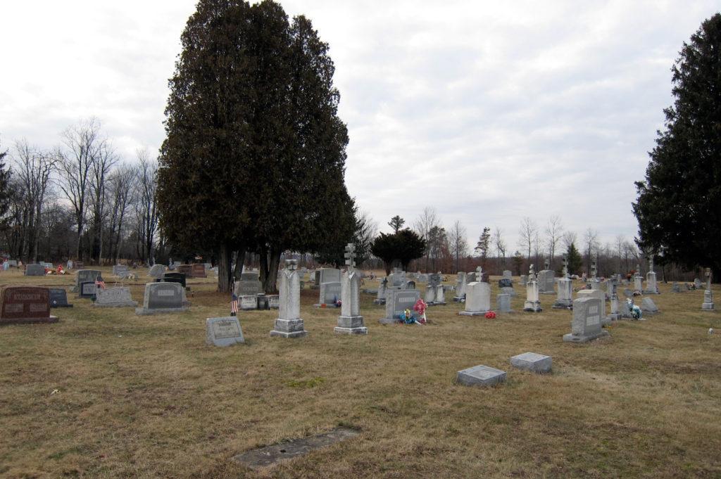 A hilltop graveyard on a winter day.