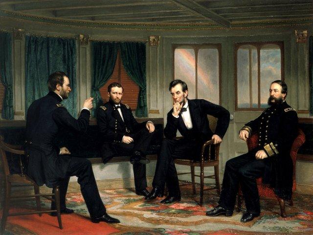 Es un cuadro del presidente Abraham Lincoln con tres personas mas sentados en sus propias sillas