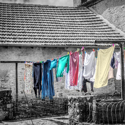 The lady dealing with the clothes ran away as soon as she saw us taking pictures in Belvès, France... But, she left behind a beautiful scene...