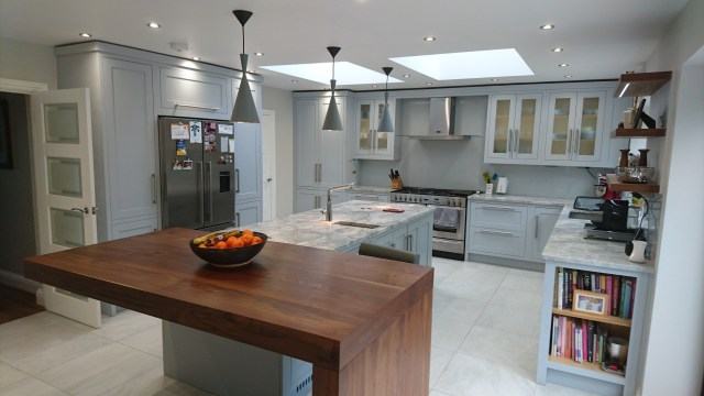 In-frame shaker kitchen near St Albans by Celtica Kitchens; walnut breakfast bar