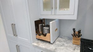 Sideways pull-out by Celtica Kitchens for instant storage of small everyday appliances such as kettle and toaster