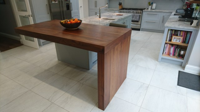 Walnut breakfast bar in kitchen in Radlett by Celtica Kitchens