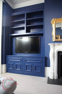 Alcove cabinets with TV enclosure and bookshelves by Celtica Kitchens
