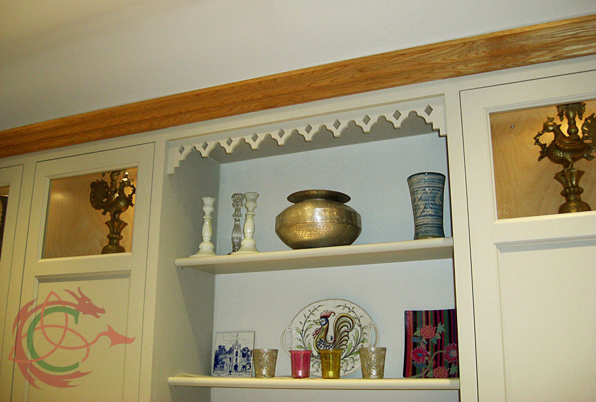 Kitchen wall cabinets with decorative fretwork freize