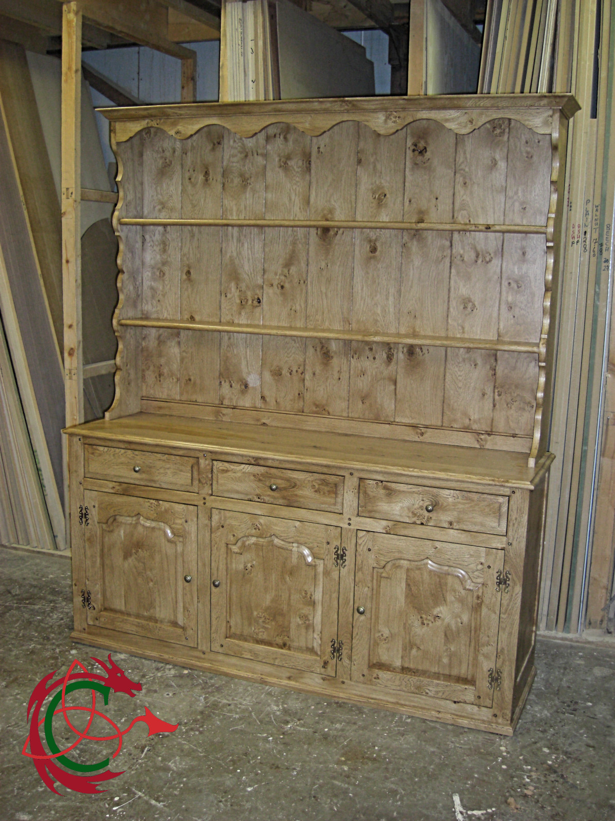 Welsh dresser: top, rack with scrollwork; bottom, sideboard with cupboards and drawers