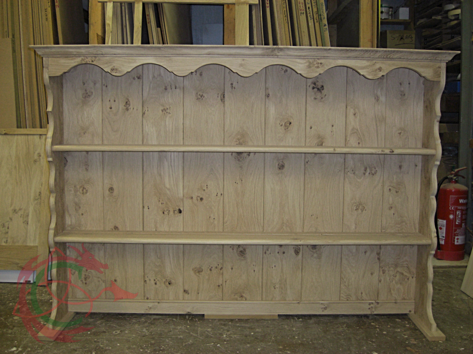 Welsh dresser rack with scrollwork freize and sides; made in pippy oak