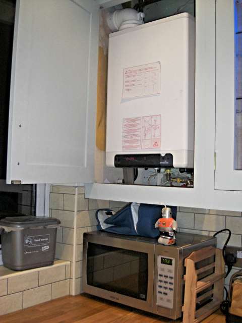 boiler in kitchen wall cabinet