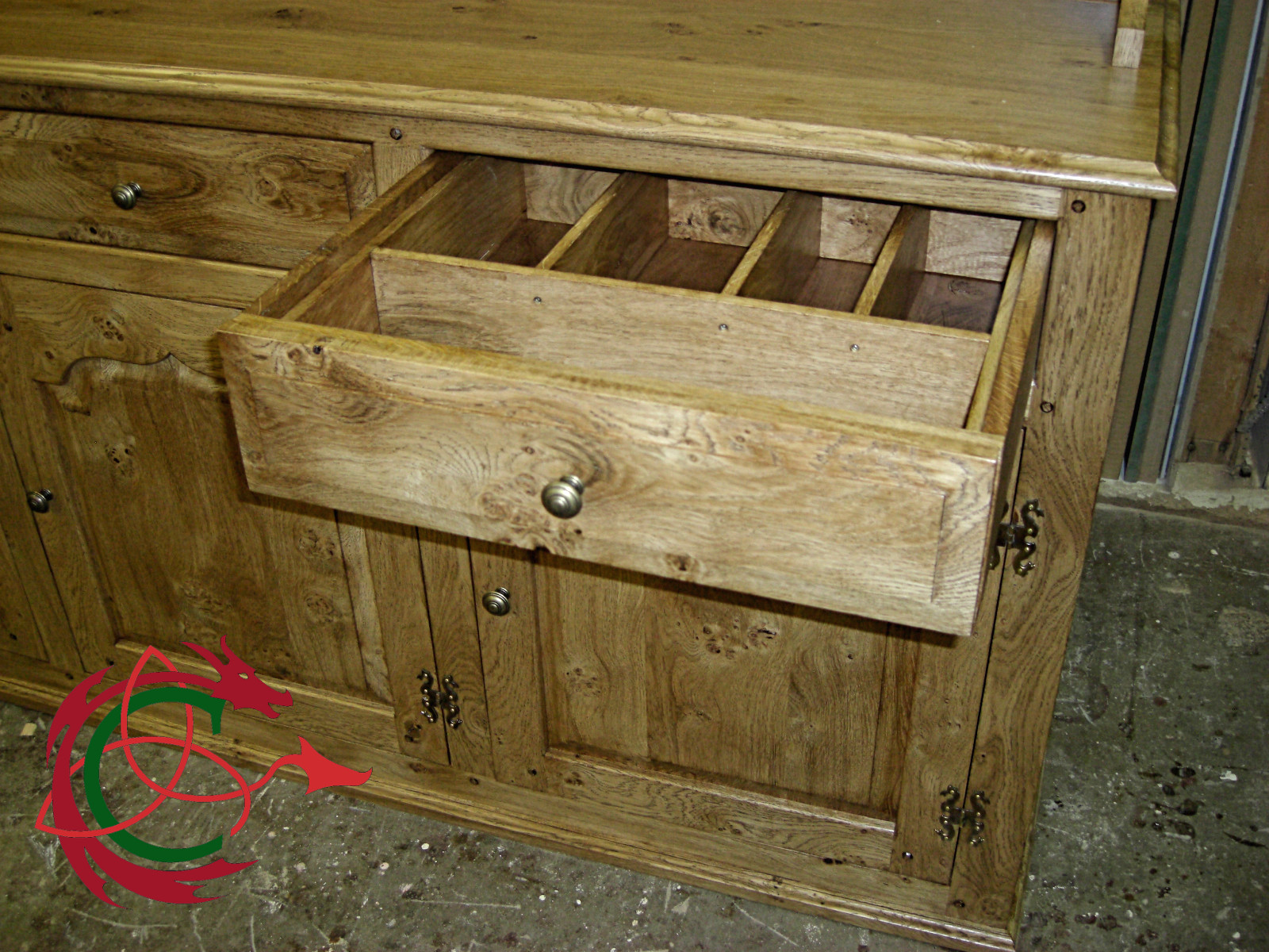 Welsh dresser sideboard with drawer open showing cutlery dividers