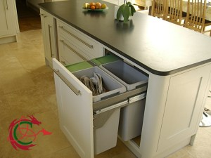 Recycling bin pull-out in kitchen island, granite worktop