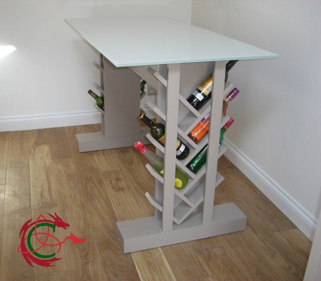 Glass topped table with integrated wine racks