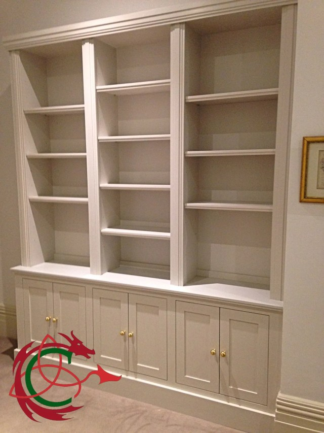 newly installed painted bespoke bookcase with adjustable shelves and cupboards
