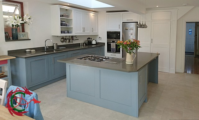 two tone painted shaker kitchen, framed cabinets, L shape island with hob, open shelves