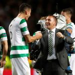 Brendan Rodgers celebrates with players