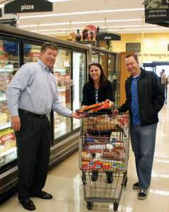 (L to R) Paul Sieczkowski, Christine Nagle and Rob Martensen shop for Colliers' adopt-a-family holiday program.