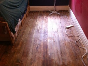 2/3 of The Captain's floor is washed and sanded.