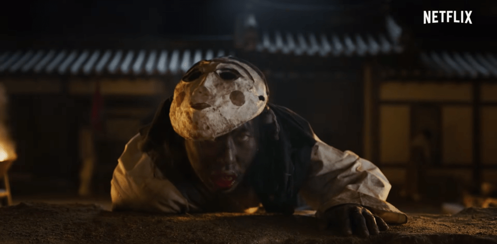Zombie crawling with mask on in promo screenshot for Kingdom Season 1