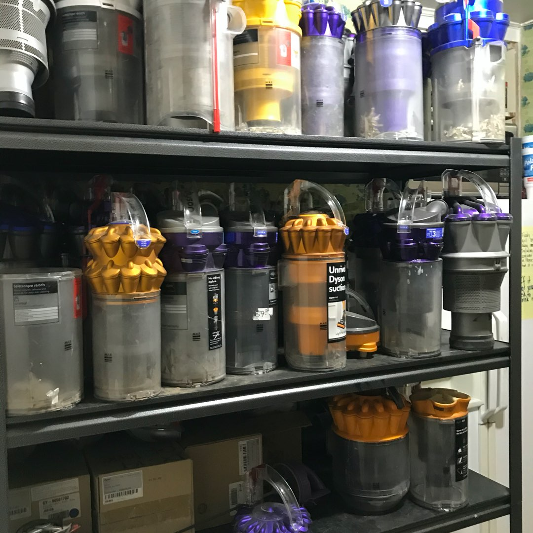 multiple Dyson Animal Cyclone parts on a shelf