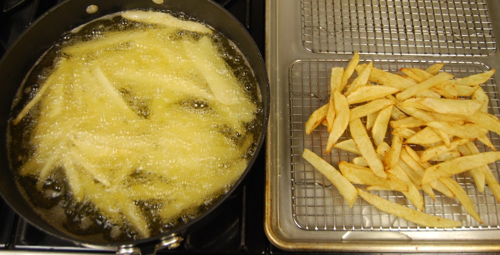 Fries in the pan on the tray