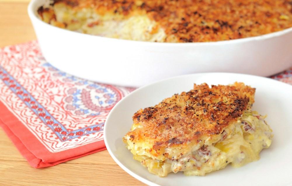 This image has an empty alt attribute; its file name is potato-leek-pancetta-gratin-recipe.jpg