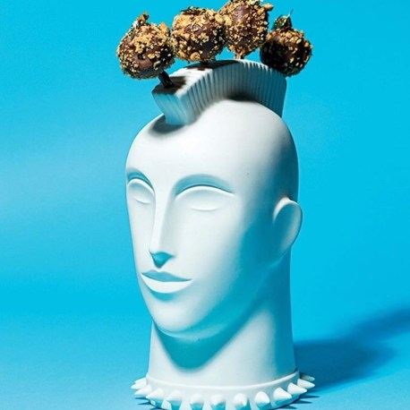 Foie gras cake pops served in a porcelain head. Photo: Scott Suchman, Washingtonian Magazine