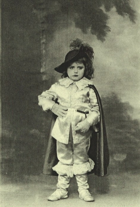 Andre Daguin as a young boy in D'Artagnan costume.
