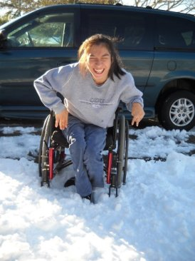 Angele West in her wheelchair in the snow