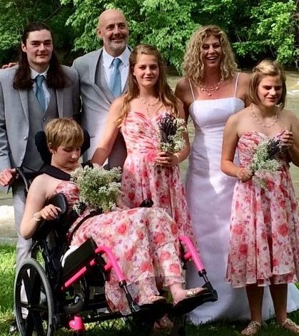 Keith and Dawn with their blended family on their wedding day.