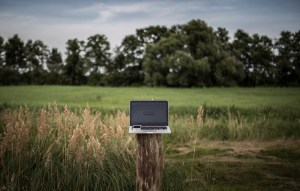 HOYERSBURG, GERMANY - AUGUST 15: In this photo illustration to the topic 'Internet access in rural areas' a laptop and a smartphone on a wooden pillar are pictured on August 15, 2017 in Hoyersburg, Germany. (Photo Illustration by Florian Gaertner/Photothek via Getty Images)