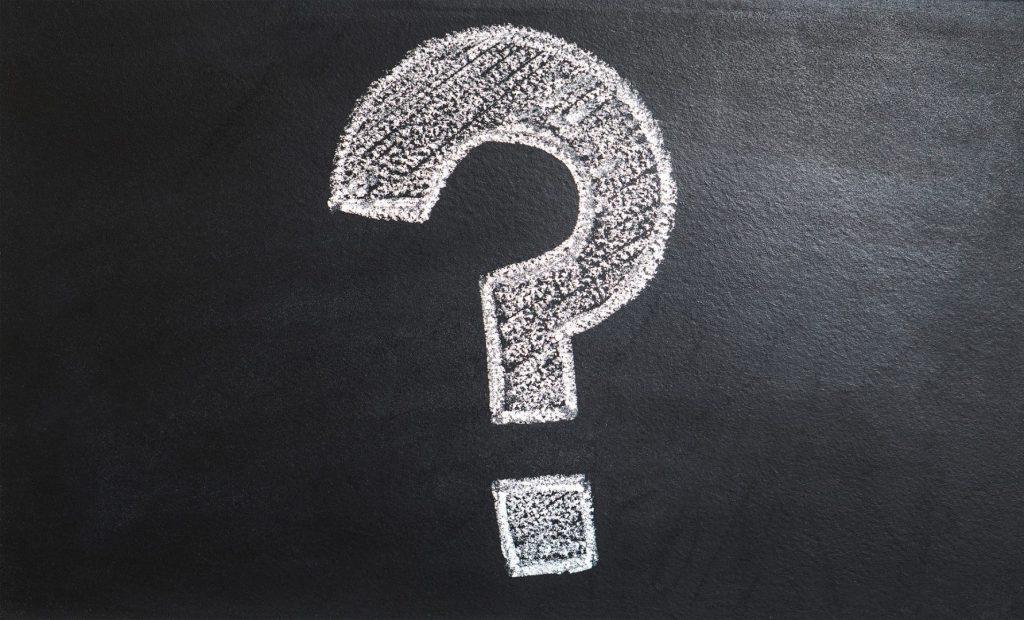 question mark written in chalk on blackboard