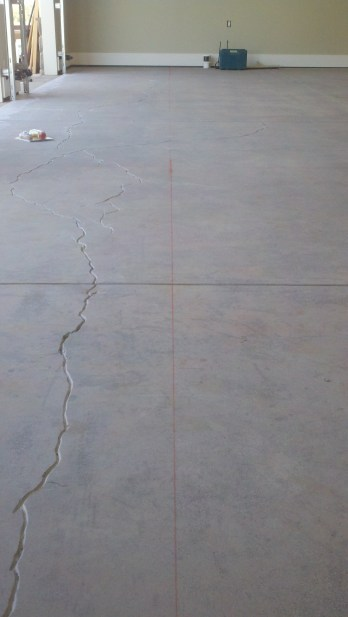 Chalk lines mark where control joints to be cut will go