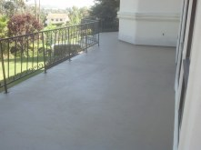 Nicely finished deck in a low knockdown texture is ready for summer fun.