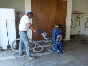 Luis runs the shotblaster over the floor to prepare it for new coatings to be applied.