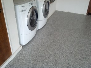 The laundry area is much cleaner now. Epoxy goes over plywood or concrete, let me show you how.