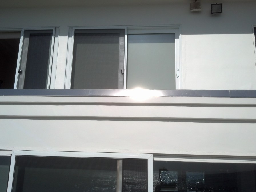 Stainless steel flashing accents the new deck