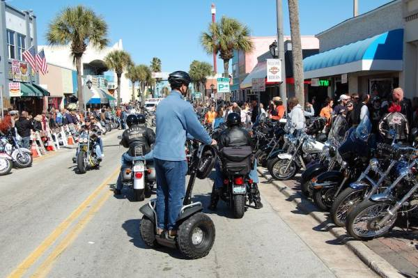 Man on a Segway at at motorcycling event on a street in Florida