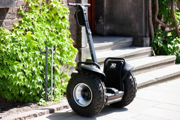 Segway parked in front of a building
