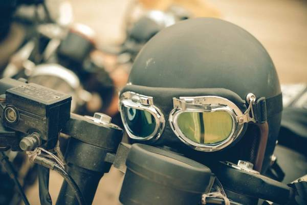 Dark green retro helmet on display in motorcycle exhibition