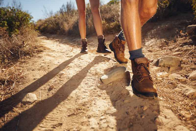 Couple hiking in a hot day waring shorts