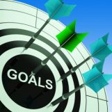 Target with arrows, bullseye is labelled GOALS
