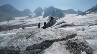 Students take a break from performing GPR data collection on the Dinwoody Glacier. Photo by Kyle Nicholoff