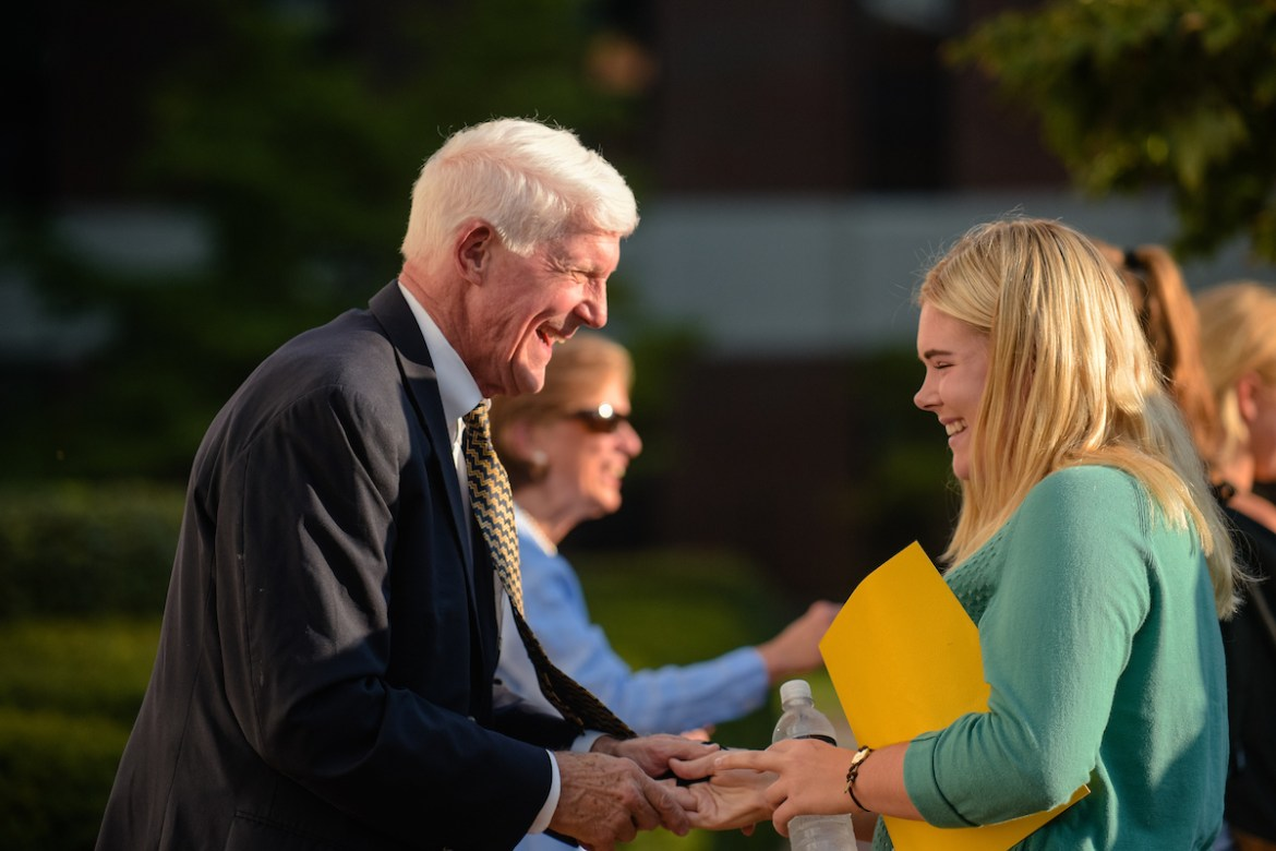 President Roush greets a female student
